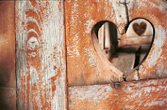 Photo of a heart cut out of a wooden fence