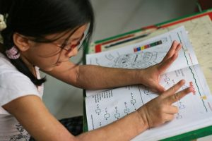 Photograph of girl learning math