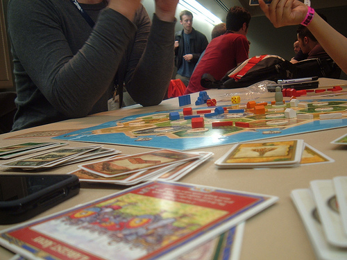 Photo of gamers playing Settlers of Catan, photo by sewing puzzle via Flickr
