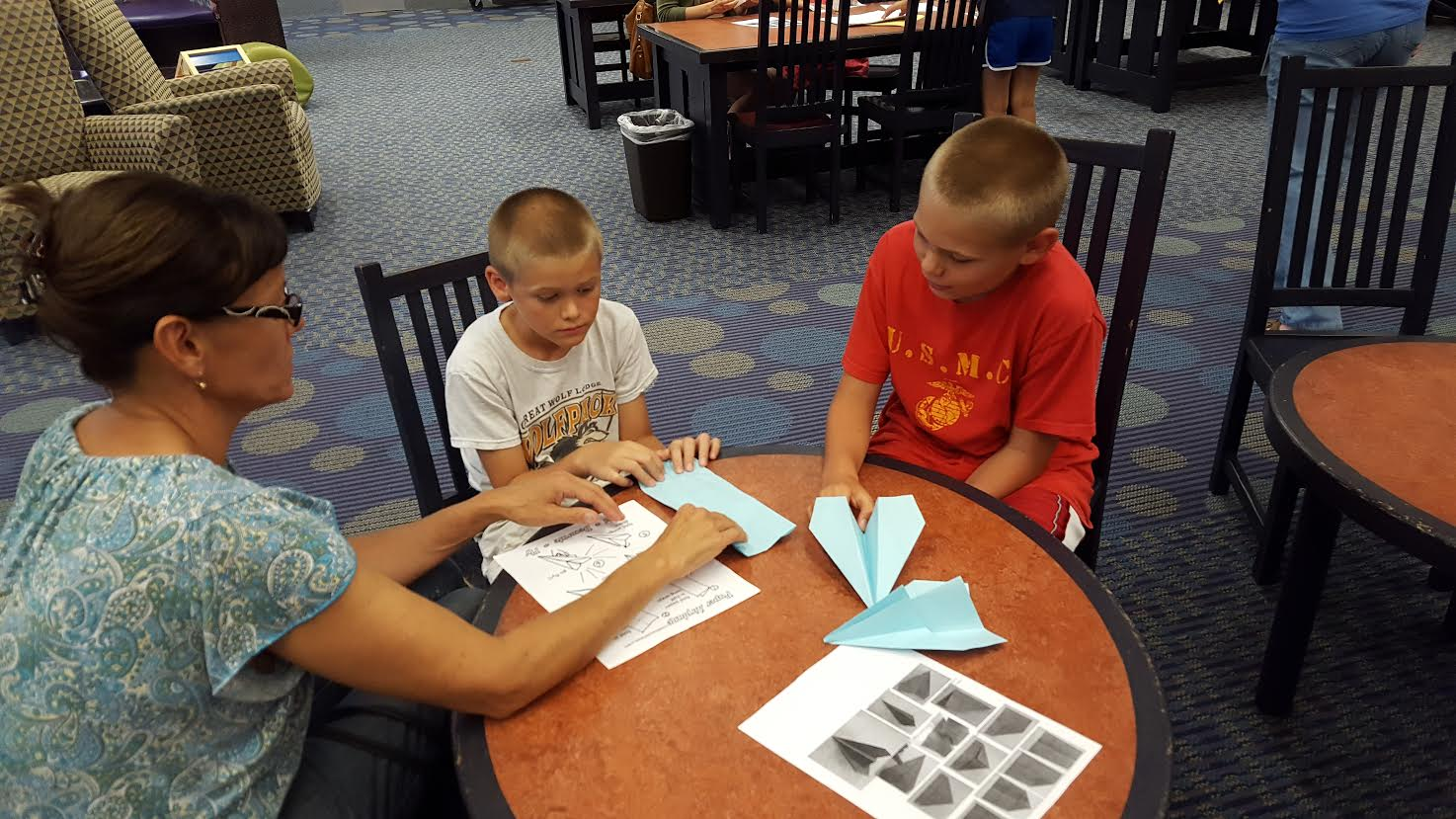 Kids making paper airplanes