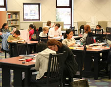 Photograph of children being tutored at the library