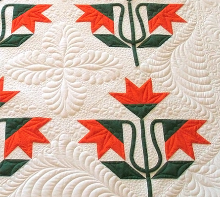 detail image of a carolina lily quilt done with computerized quilting