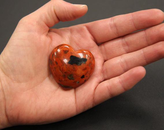 heart-shaped jasper stone held in an open hand