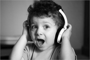 Photo of child wearing headphones