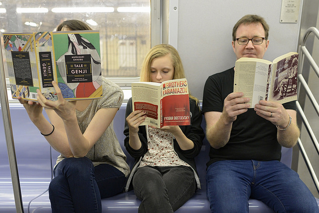 photo of people reading on the subway
