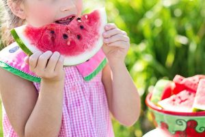 Photo of a girl eating watermelon