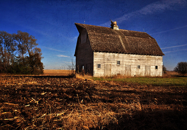 photo of harvested field and old barn