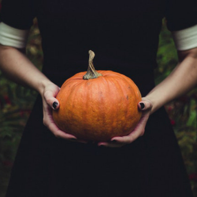 hands holding pumpkin