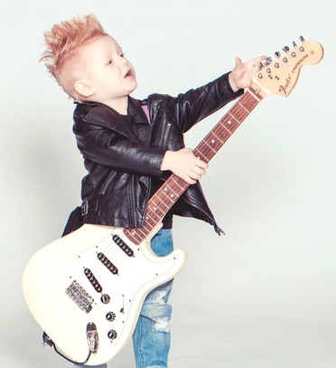 photo of a child playing a guitar