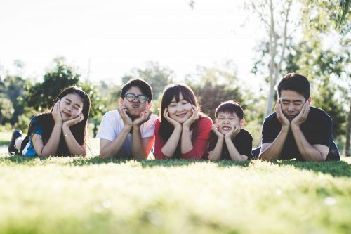 Photo of family in grass