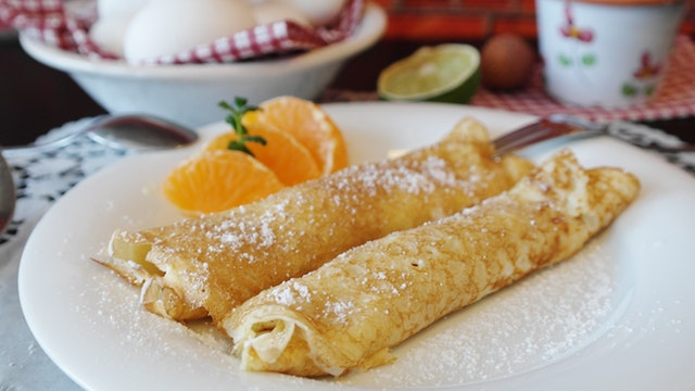 crêpes on a plate with oranges
