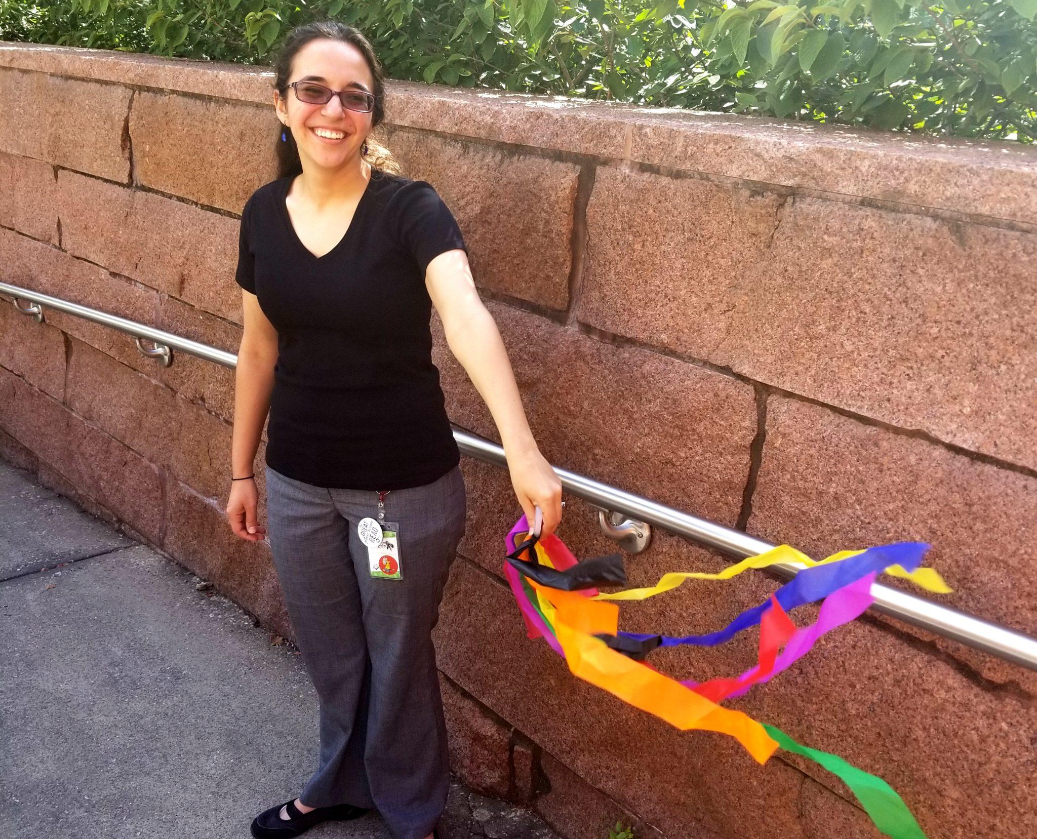 Employee holding DIY rainbow streamer