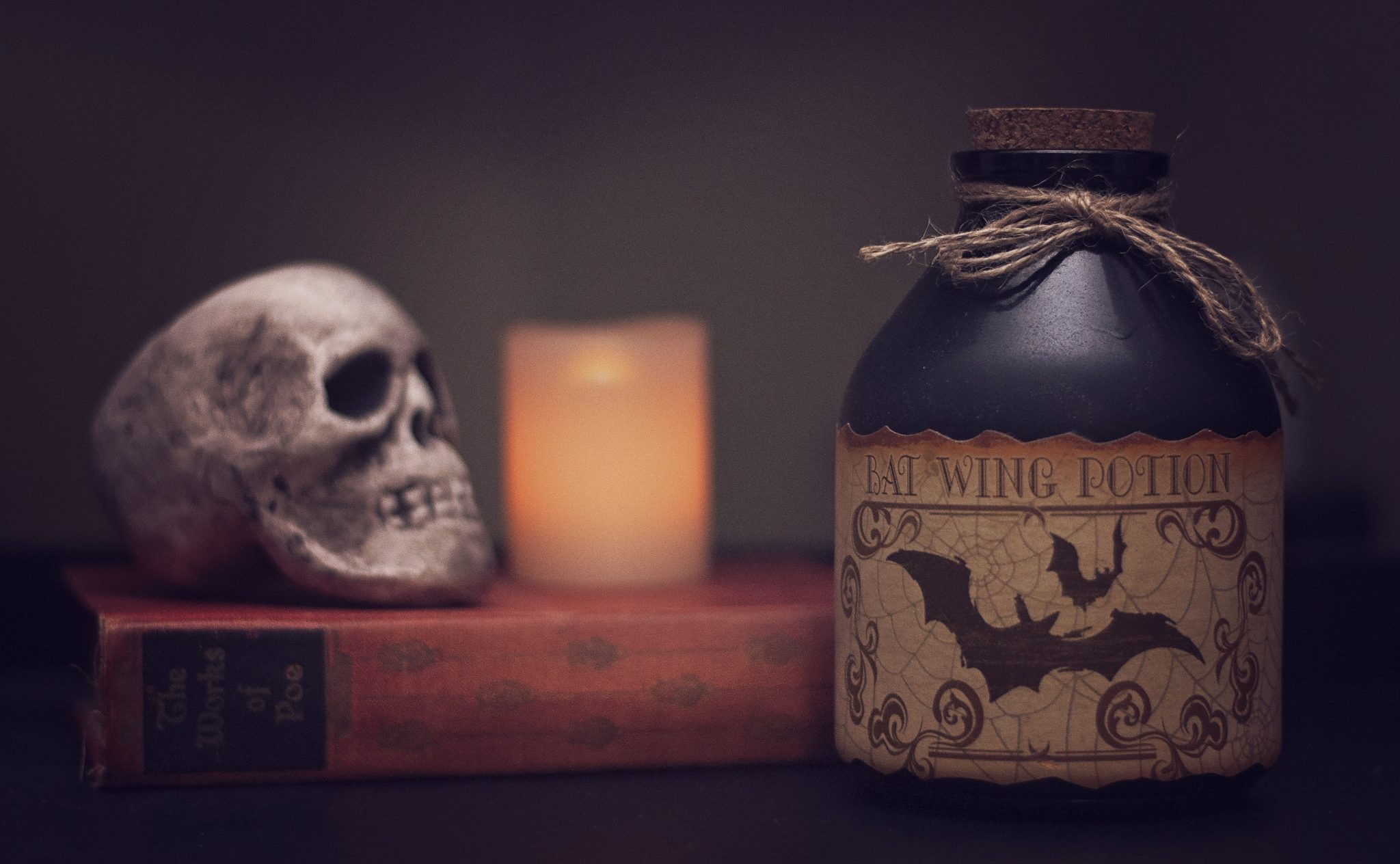 Book, skull, potion and candle