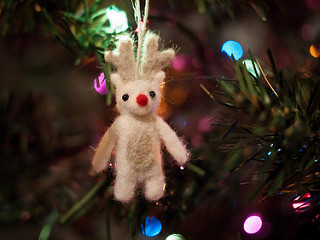 Felted reindeer ornament on tree