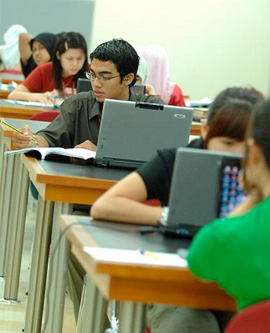 teenage students using laptops