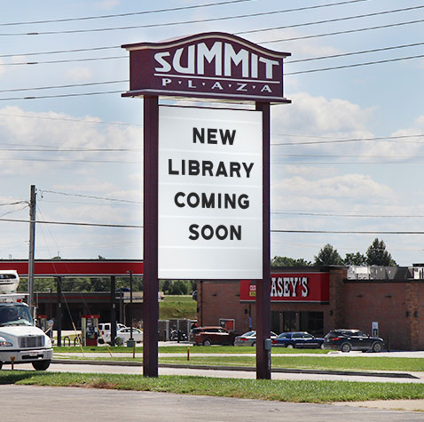 "Summit Plaza sign illustrated with the words ""New Library Coming Soon"""