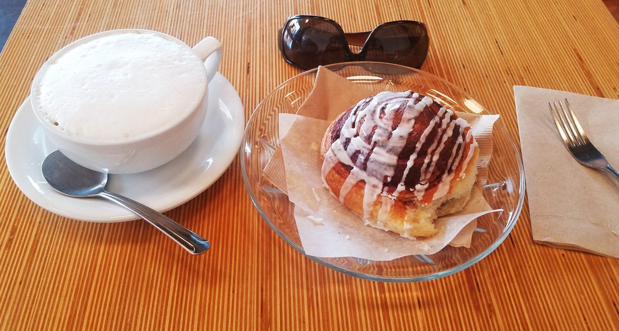 Cinnamon Roll and Cappuccino