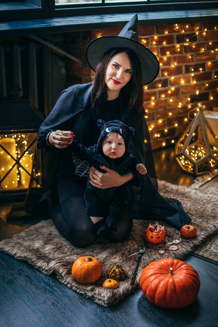 Mother and child in witch costume