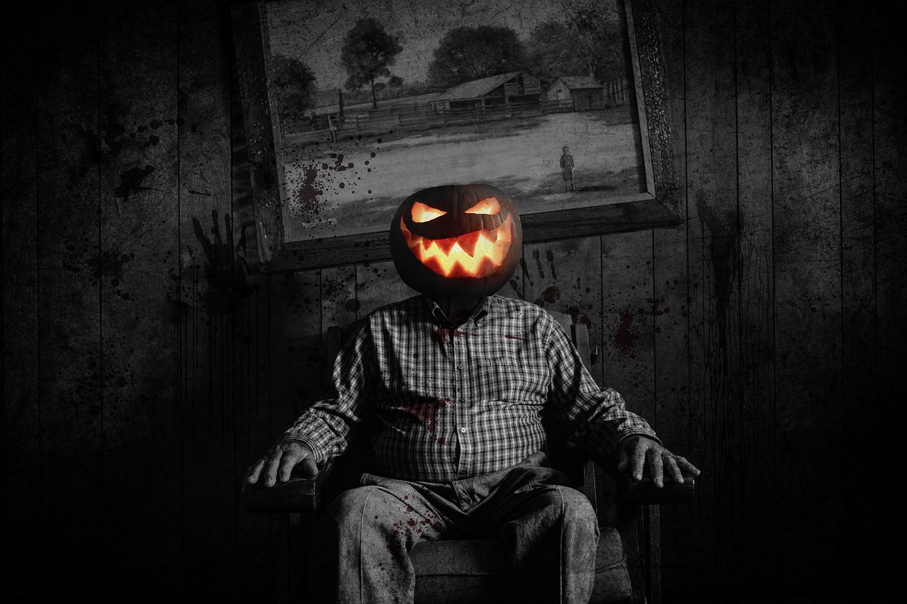 scary image of man with jack'o lantern head in dark room