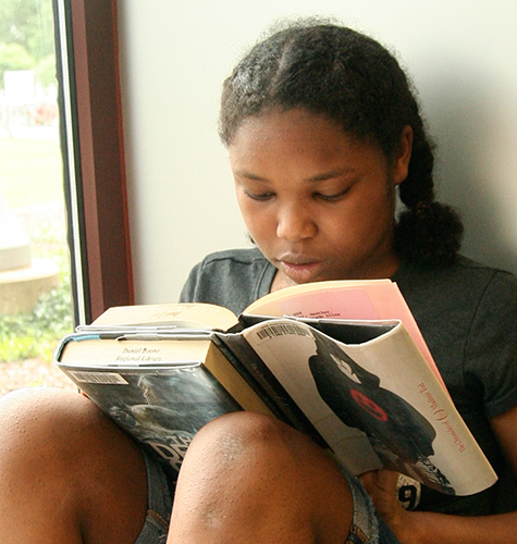 girl reading in window